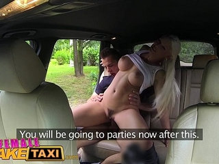 Female Fake Taxi Busty blonde rides studs cock and takes a facial