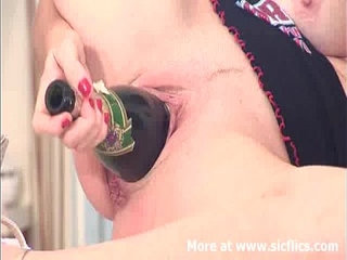 Fucking a champagne bottle backwards