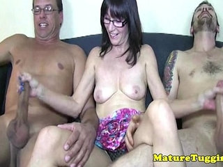 Upskirt mature tugging two cocks at sametime